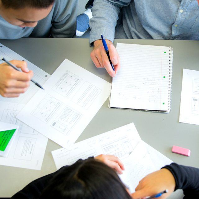 A group of students work on their assignment in class.